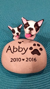 Abby's memorial stone and tiny sculptures